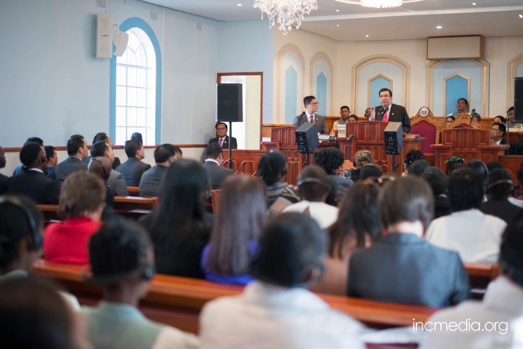 Worship Service, Executive Minister preaching in crowded sanctuary.