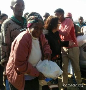 Woman holding relief goods