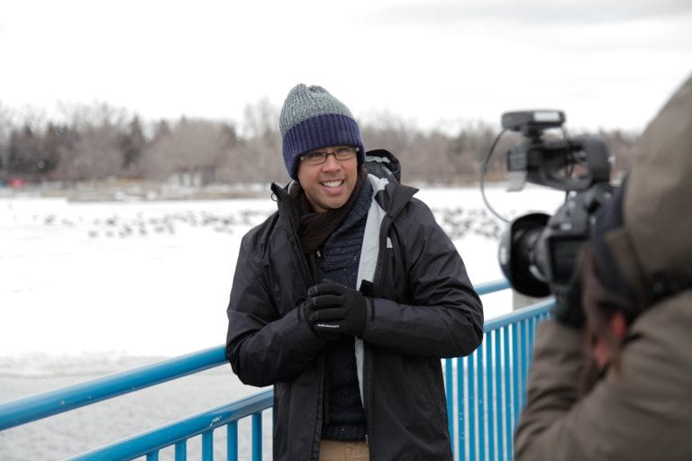 Nan Zapanta in outer winter wear smiling while in front of the camera.