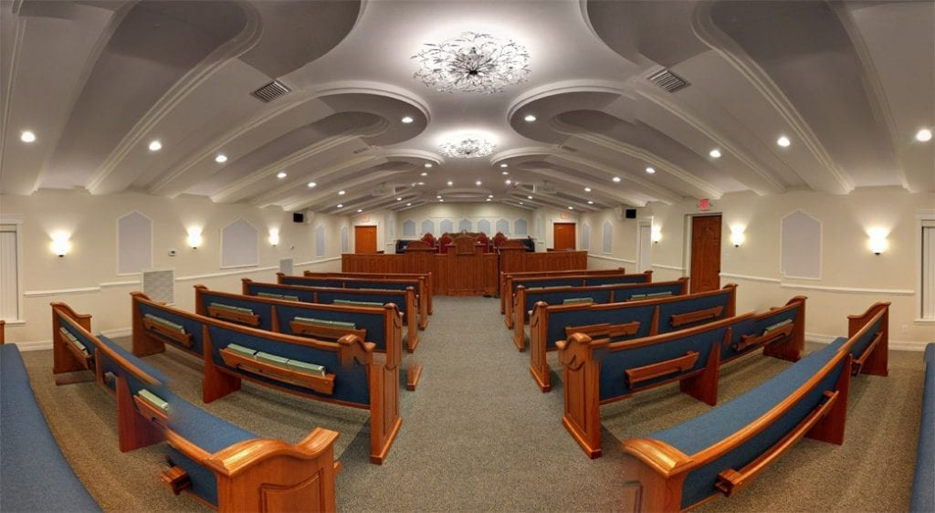 A wide angled shot from the back of the interior of the South Jacksonville house of worship.