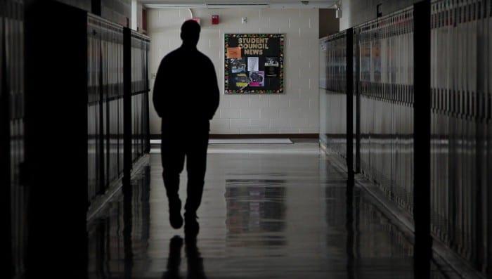 silhouette of man in school hallway