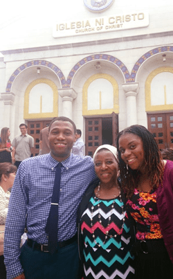 Mom with two kids and people in the background in front of the Washington D.C. worship building.