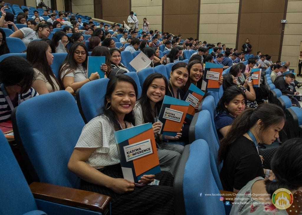 group of girls with conference folders