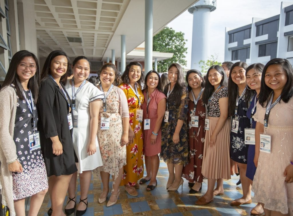 Group of girls wearing formal clothing and smiling