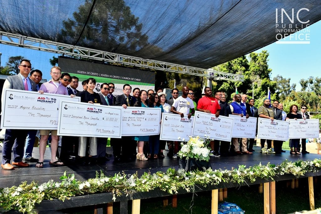 Brother Glicerio B. Santos, Jr, General Auditor of the INC and FYM Foundation Representative together with the representatives from eight local organizations from Oakland each receiving their $10,000 donation from the FYM Foundation.