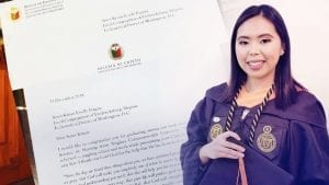A young woman's graduation photo with a letter she received from the Executive Minister of the Iglesia Ni Cristo (Church of Christ).